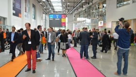 45212435 - cologne, germany - september 16, 2015 - young business people rushing by on digital marketing exhibition and trade show dmexco